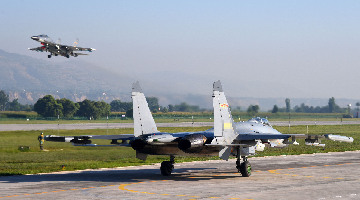 J-11 fighter jets execute combat training