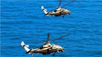 Attack helicopters fly over East China Sea