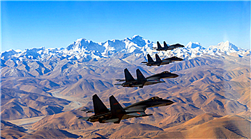 J-11 fighter jets fly over plateau area