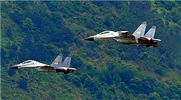 J-11 fighter jets fly through valley