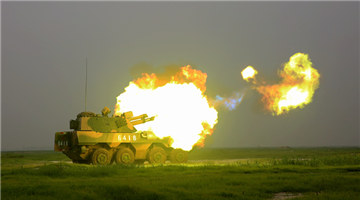 PLL-09 self-propelled howitzer system fires at targets