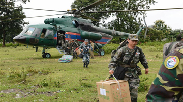 Chinese PLA medical contingent helps with relief work after dam collapses in Laos