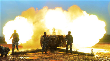 Towed howitzer systems fire in round-the-clock training