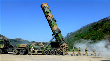 Soldiers erect DF-21A medium-range ballistic missile system