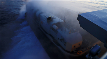 Landing Craft Air Cushion kicks up spray