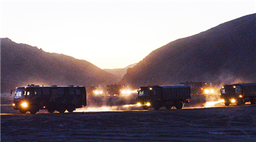 Military vehicles en route to Qilian Mountains