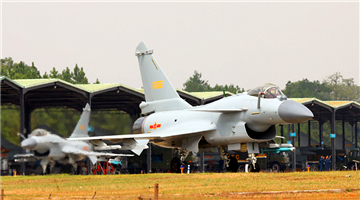 J-10 fighter jets taxi out of hangars