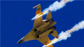 J-11 fighter jet fires at ground targets