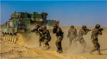 Infantrymen conduct training with MBTs
