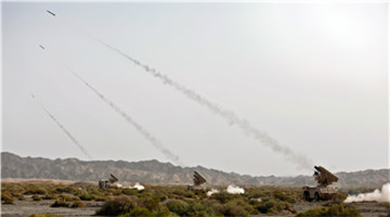 HQ-7B air defense systems fire at aerial targets