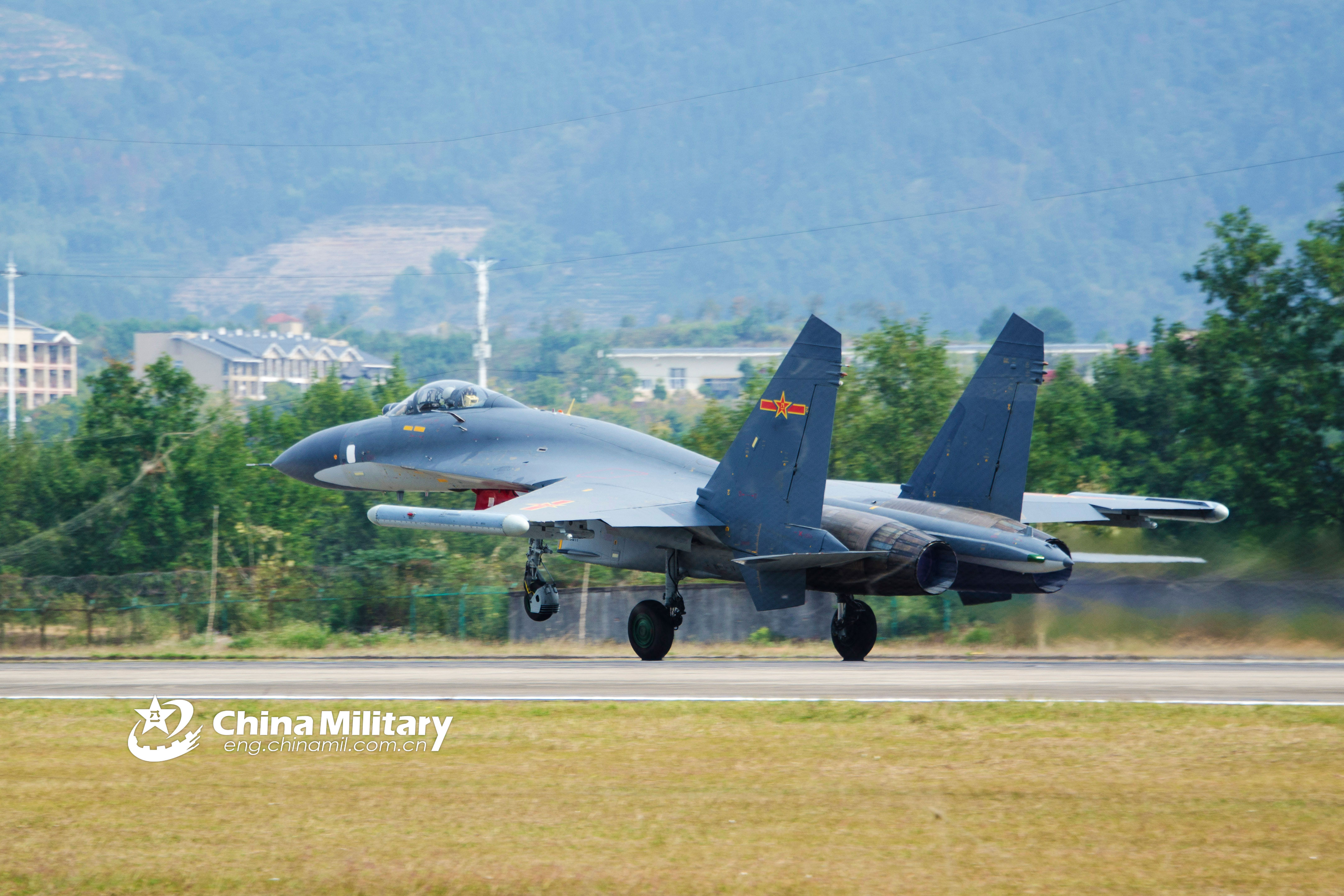 J-11 fighter jet takes off for training - China Military
