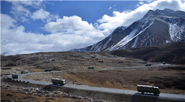 Military trucks move on Sichuan-Xizang Highway for transport mission