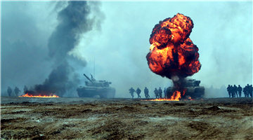 Infantrymen coordinate with tanks to assault mock enemy