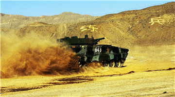 Self-propelled howitzer rumbles to traverse obstacles