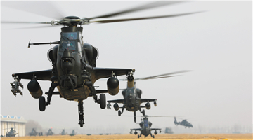 Attack helicopters lift off for flight training