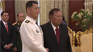 Laotian President Bounnhang Vorachit meets with PLA General Miao Hua
